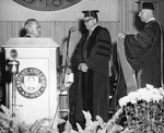 Robert E. L. Strider, President of Colby College, Receiving Honorary Degree